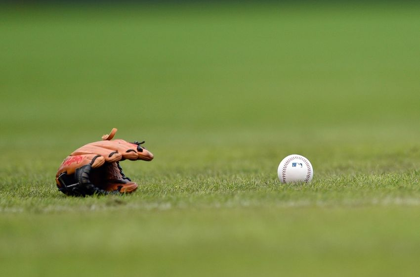 Oct 1, 2016; Philadelphia, PA, USA; A Baseball glove and ball rest on the field prior to a game between the Philadelphia Phillies and the New York Mets at Citizens Bank Park. Mandatory Credit: Derik Hamilton-USA TODAY Sports