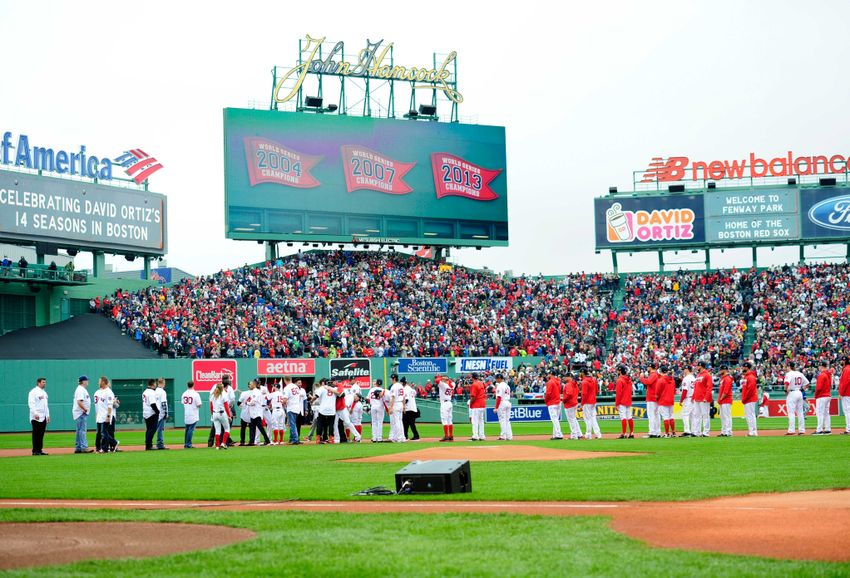 Oct 2, 2016; Boston, MA, USA; Members of the 2004 2007 2013 World Series team as well as current players gather in the infield as part of pregame ceremonies in honor of designated hitter David Ortiz (34) before a game against the Toronto Blue Jays at Fenway Park. Mandatory Credit: Bob DeChiara-USA TODAY Sports