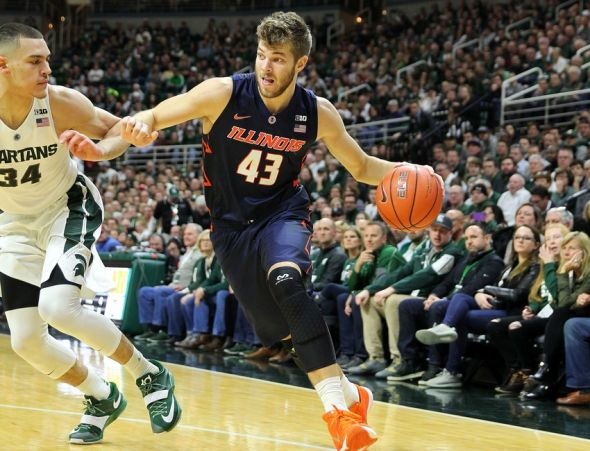 Jan 7, 2016; East Lansing, MI, USA; Illinois Fighting Illini forward Michael Finke (43) drives to the basket against Michigan State Spartans forward Gavin Schilling (34) during the 1st half of a game at Jack Breslin Student Events Center. Mandatory Credit: Mike Carter-USA TODAY Sports