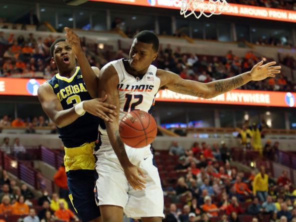 Mar 12, 2015; Chicago, IL, USA; Illinois Fighting Illini forward Leron Black (12) battles for a rebound with Michigan Wolverines guard/forward Kameron Chatman (3) during the second half in the second round of the Big Ten Conference Tournament at United Center. Mandatory Credit: Jerry Lai-USA TODAY Sports