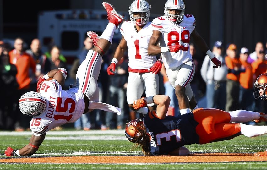 Nov 14, 2015; Champaign, IL, USA; Ohio State Buckeyes running back Ezekiel Elliott (15) is tackled by Illinois Fighting Illini defensive back Taylor Barton (3) during the third quarter at Memorial Stadium. Mandatory Credit: Mike DiNovo-USA TODAY Sports