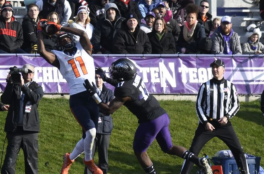 Nov 26, 2016; Evanston, IL, USA; Illinois Fighting Illini wide receiver Malik Turner (11) catches a touchdown pass in front of Northwestern Wildcats safety Marcus McShepard (17) during the second half at Ryan Field. The Northwestern Wildcats won 42-21. Mandatory Credit: David Banks-USA TODAY Sports