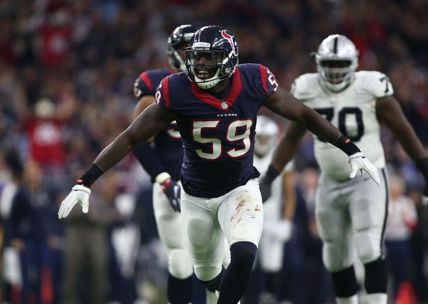 9794871-connor-cook-whitney-mercilus-nfl-afc-wild-card-oakland-raiders-houston-texans