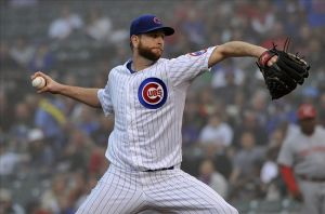 Jun 10, 2013; Chicago, IL, USA; Chicago Cubs starting pitcher Scott Feldman (46) pitches against the Cincinnati Reds during the first inning at Wrigley Field. Mandatory Credit: David Banks-USA TODAY Sports