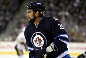 NHL: Pittsburgh Penguins at Winnipeg Jets Jan 25, 2013; Winnipeg, MB, CAN; Winnipeg Jets defenseman Dustin Byfuglien (33) during the first period against the Pittsburgh Penguins at the MTS Centre. Mandatory Credit: Bruce Fedyck-USA TODAY Sports