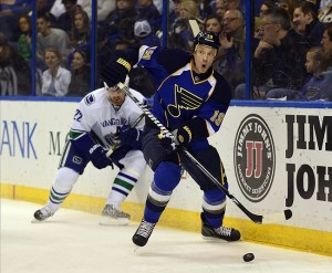 Apr 16, 2013; St. Louis, MO, USA; St. Louis Blues defenseman Jay Bouwmeester (19) looks to pass against the Vancouver Canucks during the first period at the Scottrade Center. Credit: Scott Rovak-USA TODAY Sports