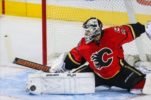 Apr 19, 2013; Calgary, Alberta, CAN; Calgary Flames goalie Miikka Kiprusoff (34) makes a save against the Anaheim Ducks during the third period at the Scotiabank Saddledome. Calgary Flames won 3-1. Mandatory Credit: Sergei Belski-USA TODAY Sports