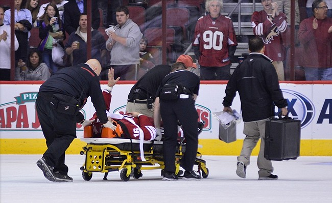 Sep 15, 2013; Glendale, AZ, USA; Phoenix Coyotes defenseman Rostislav Klesla (16) waves to the crowd while being taken off the ice on a stretcher during the first period against the Los Angeles Kings at Jobing.com Arena. Mandatory Credit: Matt Kartozian-USA TODAY Sports