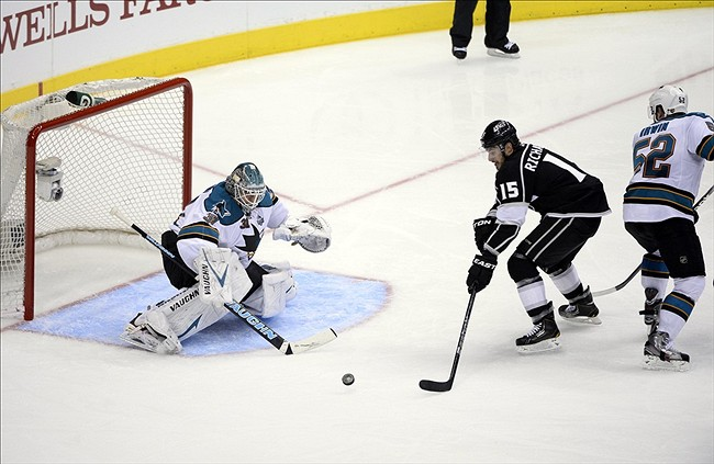 NHL: Stanley Cup Playoffs-San Jose Sharks at Los Angeles KingsMay 28, 2013; Los Angeles, CA, USA; San Jose Sharks goalie Antti Niemi (31) makes a save on a shot by Los Angeles Kings center Brad Richardson (15) as Sharks defenseman Matt Irwin (52) looks on in the second period of game seven of the second round of the 2013 Stanley Cup Playoffs at the Staples Center. Mandatory Credit: Robert Hanashiro-USA TODAY Sports