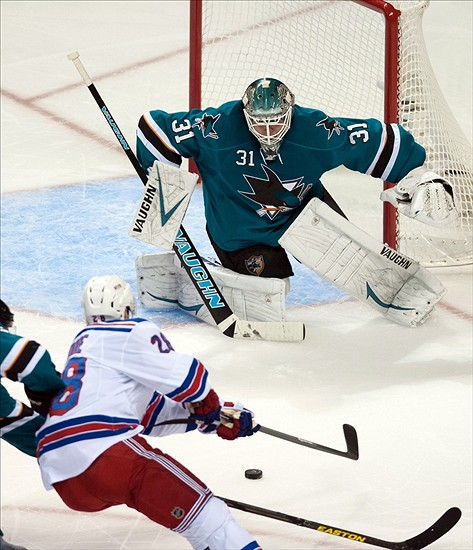 Oct 8, 2013; San Jose, CA, USA; San Jose Sharks goalie Antti Niemi (31) defends the goal against New York Rangers center Derek Stepan (21) during the second period at SAP Center at San Jose. Mandatory Credit: Ed Szczepanski-USA TODAY Sports