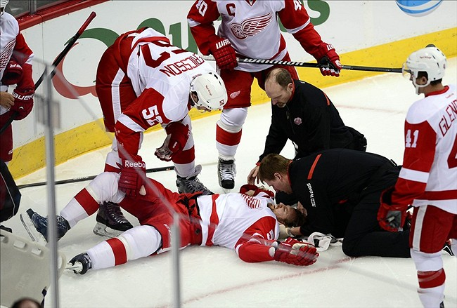 Oct 17, 2013; Denver, CO, USA; Detroit Red Wings defenseman Niklas Kronwall (55) lays injured after being boarded by Colorado Avalanche left wing Cody McLeod (55) (not pictured) in the first period at Pepsi Center. Mandatory Credit: Ron Chenoy-USA TODAY Sports