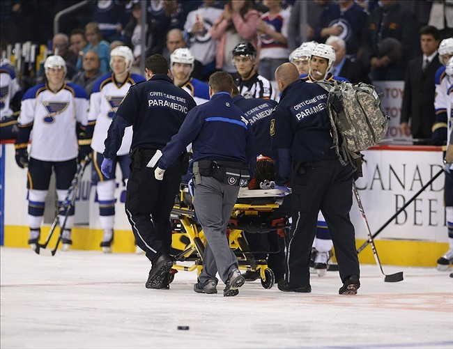 Oct 18, 2013; Winnipeg, Manitoba, CAN; Winnipeg Jets defenseman Jacob Trouba (8) is taken away by EMS during the second period at MTS Centre. Mandatory Credit: Bruce Fedyck-USA TODAY Sports