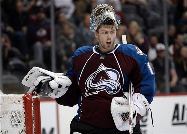 Oct 25, 2013; Denver, CO, USA; Colorado Avalanche goalie Semyon Varlamov (1) during a time out in the third period against the Carolina Hurricanes at Pepsi Center. The Avalanche defeated the Hurricanes Mandatory Credit: Ron Chenoy-USA TODAY Sports