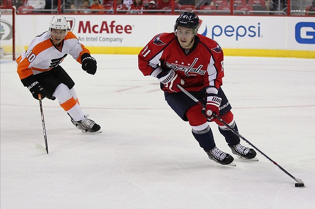Sep 27, 2013; Washington, DC, USA; Washington Capitals defenseman Dmitry Orlov (81) skates with the puck as Philadelphia Flyers center Brayden Schenn (10) chases in the second period at Verizon Center. The Capitals won 6-3. Mandatory Credit: Geoff Burke-USA TODAY Sports