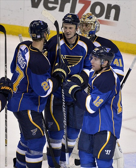 Oct 3, 2013; St. Louis, MO, USA; St. Louis Blues defenseman Jay Bouwmeester (middle) and Jaroslav Halak (top) congratulate teammates Alex Pietrangelo (left) and Alexander Steen (right) after winning the game against the Nashville Predators at Scottrade Center. The Blues defeat the Predators 4-2. Mandatory Credit: Jasen Vinlove-USA TODAY Sports