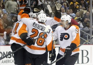 Nov 13, 2013; Pittsburgh, PA, USA; The Philadelphia Flyers celebrate a goal by center Brayden Schenn (hidden) against the Pittsburgh Penguins during the first period at the CONSOL Energy Center. Mandatory Credit: Charles LeClaire-USA TODAY Sports
