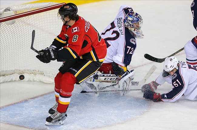 Nov 20, 2013; Calgary, Alberta, CAN; Calgary Flames center Joe Colborne (8) scores a goal against the Columbus Blue Jackets during the third period at Scotiabank Saddledome. Columbus Blue Jackets won 2-1. Mandatory Credit: Sergei Belski-USA TODAY Sports