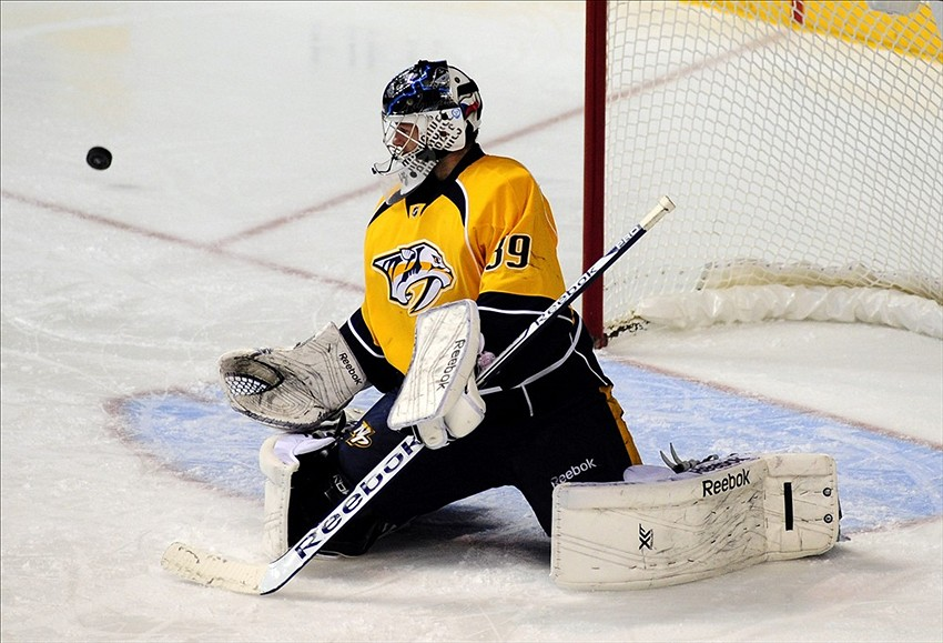 Nov 28, 2013; Nashville, TN, USA; Nashville Predators goalie Marek Mazanec (39) stops a shot during the second period against the Edmonton Oilers at Bridgestone Arena. Mandatory Credit: Mike Strasinger-USA TODAY Sports