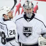 Dec 14, 2013; Ottawa, Ontario, CAN; Los Angeles Kings center Jarret Stoll (28) congratulates goalie Martin Jone (31) following their win against the Ottawa Senators at the Canadian Tire Centre. The Kings defeated the Senators 5-2. Mandatory Credit: Marc DesRosiers-USA TODAY Sports