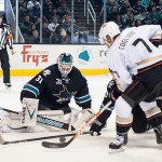 Dec 29, 2013; San Jose, CA, USA; San Jose Sharks goalie Antti Niemi (31) blocks a shot by Anaheim Ducks center Andrew Cogliano (7) during the second period at SAP Center at San Jose. The San Jose Sharks defeated the Anaheim Ducks 3-1. Mandatory Credit: Ed Szczepanski-USA TODAY Sports