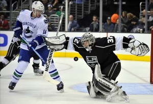 NHL: Vancouver Canucks at Los Angeles KingsNovember 9, 2013; Los Angeles, CA, USA; Los Angeles Kings goalie Jonathan Quick (32) blocks a shot as Vancouver Canucks left wing Alex Burrows (14) is in position for the rebound during the first period at Staples Center. Mandatory Credit: Gary A. Vasquez-USA TODAY Sports