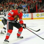 Dec 30, 2013; Chicago, IL, USA; Chicago Blackhawks right wing Patrick Kane (88) with the puck during the second period against the Los Angeles Kings at the United Center. Mandatory Credit: Dennis Wierzbicki-USA TODAY Sports