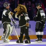 Jan 13, 2014; Los Angeles, CA, USA; Los Angeles Kings mascot Bailey (center) congratulates goalie Jonathan Quick (32) and right wing Dustin Brown (23) at the end of the game against the Vancouver Canucks at Staples Center. The Kings defeated the Canucks 1-0. Mandatory Credit: Kirby Lee-USA TODAY Sports
