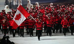 Feb 7, 2014; Sochi, RUSSIA; Hayley Wickenheiser leads the delegation from Canada during the opening ceremony for the Sochi 2014 Olympic Winter Games at Fisht Olympic Stadium. Mandatory Credit: Jerry Lai-USA TODAY Sports