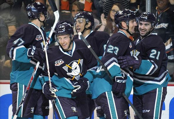 October 13, 2013; Anaheim, CA, USA; Anaheim Ducks center Nick Bonino (13) is congratulated after scoring a goal against the Ottawa Senators during the second period at the Honda Center. Mandatory Credit: Gary A. Vasquez-USA TODAY Sports