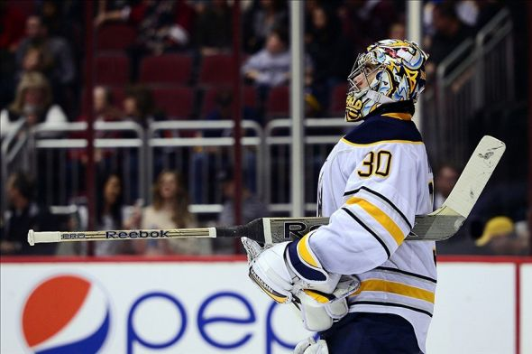 Jan 30, 2014; Glendale, AZ, USA; Buffalo Sabres goalie Ryan Miller (30) stands on the ice in the second period against the Phoenix Coyotes at Jobing.com Arena. Mandatory Credit: Jennifer Stewart-USA TODAY Sports