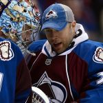 Jan 30, 2014; Denver, CO, USA; Colorado Avalanche goalie Semyon Varlamov (1) is congratulated for the win by Colorado Avalanche goalie Jean-Sebastien Giguere (35) against the Minnesota Wild at the Pepsi Center. The Avalanche defeated the Wild 5-4. Mandatory Credit: Ron Chenoy-USA TODAY Sports