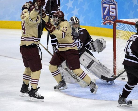 Apr 10, 2014; Philadelphia, PA, USA; Boston College Eagles forward Johnny Gaudreau (13) celebrates his goal with teammate forward Bill Arnold (24) against Union Dutchmen goalie Colin Stevens (30) and defenseman Jeff Taylor (2) during the first period in the semifinals of the Frozen Four college ice hockey tournament at Wells Fargo Center. Mandatory Credit: Eric Hartline-USA TODAY Sports