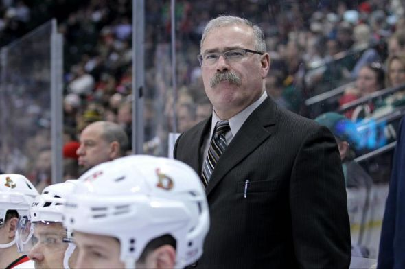 Jan 14, 2014; Saint Paul, MN, USA; Ottawa Senators head coach Paul MacLean looks on during the third period against the Minnesota Wild at Xcel Energy Center. The Senators defeated the Wild 3-0. Mandatory Credit: Brace Hemmelgarn-USA TODAY Sports