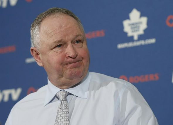 Apr 5, 2014; Toronto, Ontario, CAN; Toronto Maple Leafs head coach Randy Carlyle addresses the media in a post game media conference after a loss to the Winnipeg Jets at the Air Canada Centre. Winnipeg defeated Toronto 4-2. Mandatory Credit: John E. Sokolowski-USA TODAY Sports