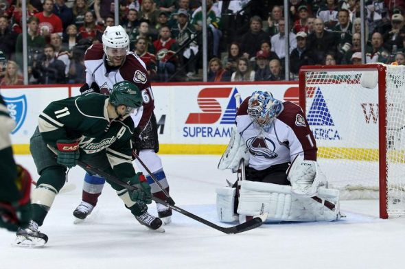 Apr 28, 2014; Saint Paul, MN, USA; Minnesota Wild forward Mikael Granlund (not pictured) scores a goal on Colorado Avalanche goalie Semyon Varlamov (1) during the first period in game six of the first round of the 2014 Stanley Cup Playoffs at Xcel Energy Center. Mandatory Credit: Brace Hemmelgarn-USA TODAY Sports