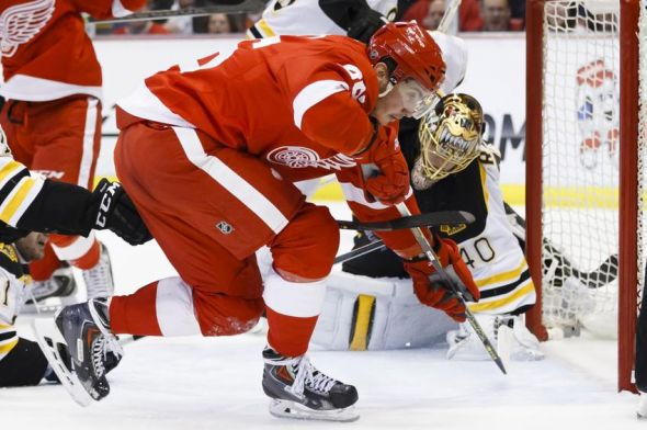 Apr 2, 2014; Detroit, MI, USA; Detroit Red Wings right wing Tomas Jurco (26) scores a goal on Boston Bruins goalie Tuukka Rask (40) in the third period at Joe Louis Arena. Detroit won 3-2. Mandatory Credit: Rick Osentoski-USA TODAY Sports
