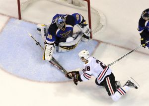 Apr 25, 2014; St. Louis, MO, USA; St. Louis Blues goalie Ryan Miller (39) makes a save against Chicago Blackhawks right wing Ben Smith (28) during the second period in game five of the first round of the 2014 Stanley Cup Playoffs at Scottrade Center. The Blackhawks defeated the Blues 3-2. Mandatory Credit: Scott Rovak-USA TODAY Sports
