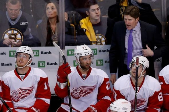 Apr 26, 2014; Boston, MA, USA; Detroit Red Wings head coach Mike Babcock (R) reacts from behind the bench during the third period against the Boston Bruins in game five of the first round of the 2014 Stanley Cup Playoffs at TD Banknorth Garden. The Bruins won 4-2. Mandatory Credit: Greg M. Cooper-USA TODAY Sports