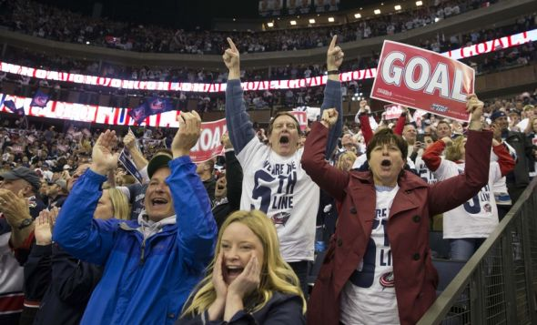 Apr 28, 2014; Columbus, OH, USA; Columbus Blue Jackets fans react after their team