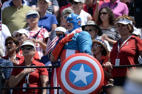 Aug 17, 2013; Parker, CO, USA; A Team U.S. fan dressed as Captain America reacst from the gallery on the first hole during the final round of the 2013 Solheim Cup at the Colorado Golf Club. Mandatory Credit: Ron Chenoy-USA TODAY Sports