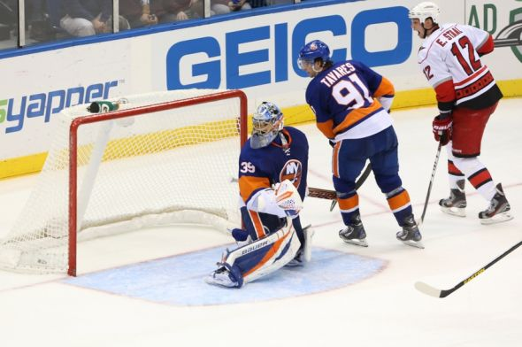 Feb 11, 2013; Uniondale, NY, USA; New York Islanders goalie Rick DiPietro (39) looks back on his missed save during the third period against the Carolina Hurricanes at Nassau Veterans Memorial Coliseum. Carolina won 6-4. Mandatory Credit: Anthony Gruppuso-USA TODAY Sports