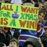 Dec 23, 2014; Edmonton, Alberta, CAN; Edmonton Oilers fan holds up a sign against the Arizona Coyotes during the third period at Rexall Place. Mandatory Credit: Perry Nelson-USA TODAY Sports