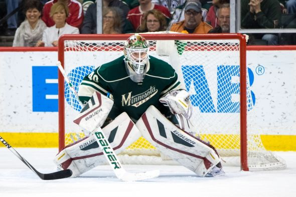 Mar 28, 2015; Saint Paul, MN, USA; Minnesota Wild goalie Devan Dubnyk (40) in the second period against the Los Angeles Kings at Xcel Energy Center. The Minnesota Wild beat the Los Angeles Kings 4-1. Mandatory Credit: Brad Rempel-USA TODAY Sports