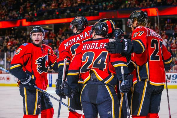 Feb 25, 2016; Calgary, Alberta, CAN; Calgary Flames left wing Jiri Hudler (24) celebrates his goal with teammates against the New York Islanders during the first period at Scotiabank Saddledome. Mandatory Credit: Sergei Belski-USA TODAY Sports