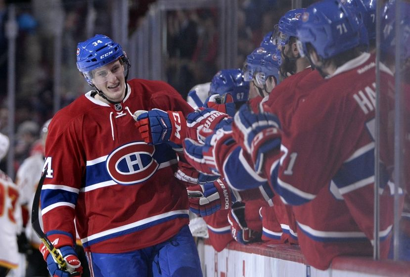 Mar 20, 2016; Montreal, Quebec, CAN; Montreal Canadiens forward Michael McCarron (34) celebrates with teammates after scoring a goal against the Calgary Flames during the third period at the Bell Centre. It was McCarron