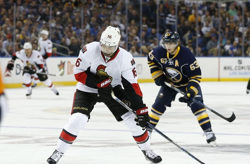 Oct 8, 2015; Buffalo, NY, USA; Ottawa Senators left wing Clarke MacArthur (16) takes a shot as Buffalo Sabres left wing Tyler Ennis (63) pursues during the first period at First Niagara Center. Mandatory Credit: Kevin Hoffman-USA TODAY Sports