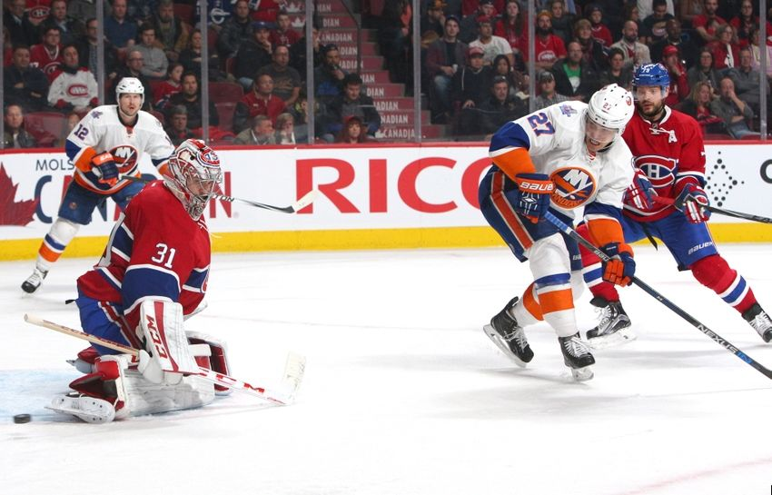 Nov 22, 2015; Montreal, Quebec, CAN; Montreal Canadiens goalie Carey Price (31) makes a save against New York Islanders center Anders Lee (27) as defenseman Andrei Markov (79) defends during the third period at Bell Centre. Mandatory Credit: Jean-Yves Ahern-USA TODAY Sports