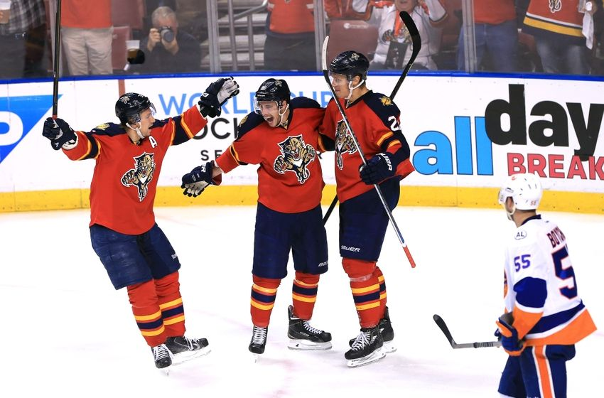 Apr 15, 2016; Sunrise, FL, USA; Florida Panthers center Nick Bjugstad (27) celebrates his goal with right wing Reilly Smith (18) and left wing Jussi Jokinen (36) as New York Islanders defenseman Johnny Boychuk (55) looks on in the second period in game two of the first round of the 2016 Stanley Cup Playoffs at BB&T Center. Mandatory Credit: Robert Mayer-USA TODAY Sports