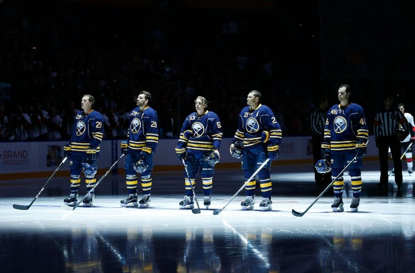 Sep 27, 2016; Buffalo, NY, USA; Buffalo Sabres defenseman Jake McCabe (29), center Zemgus Girgensons (28), left wing Tyler Ennis (63), right wing Kyle Okposo (21) and defenseman Erik Burgdoerfer (46) stand for the national anthem before the game against the Ottawa Senators at KeyBank Center. Mandatory Credit: Kevin Hoffman-USA TODAY Sports