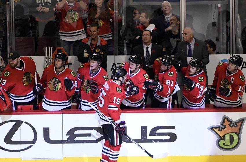 Nov 1, 2016; Chicago, IL, USA; Chicago Blackhawks center Artem Anisimov (15) celebrates his gaol against Calgary Flames with his teammates during the third period at the United Center. The Hawks won 5-1. Mandatory Credit: David Banks-USA TODAY Sports
